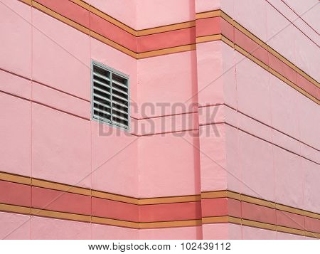 Ventilation Grille Mounted On Pink Wall Of Building.