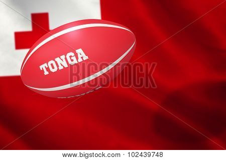 Tonga rugby ball against close-up of tongan flag