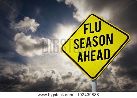 flu season ahead against dark sky with white clouds