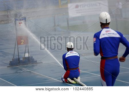ST. PETERSBURG, RUSSIA - SEPTEMBER 9, 2015: Team Czech Republic during competitions in combat deployment during XI World Championship in Fire and Rescue Sport. 1st World Championship was held in 2002