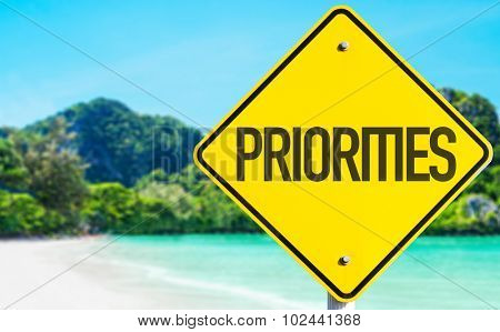 Priorities sign with beach background
