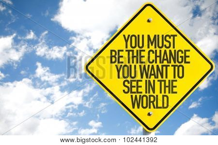 You Must Be The Change You Want To See In The World sign with sky background
