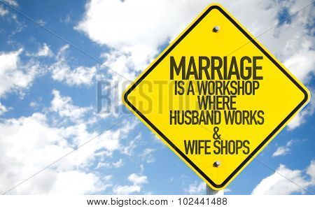 Marriage Is a Workshop Where Husband Works & Wife Shops sign with sky background