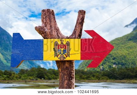 Moldova Flag wooden sign with countryside background