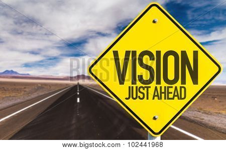 Vision Just Ahead sign on desert road