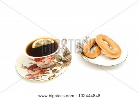 Two Bagels And Cup Of Tea With Lemon