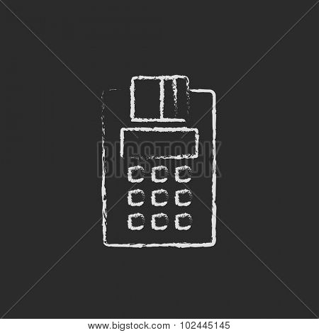 Cash register hand drawn in chalk on a blackboard vector white icon isolated on a black background.