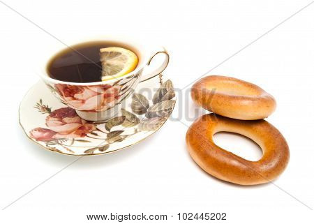 Cup Of Tea With Lemon And Two Bagels