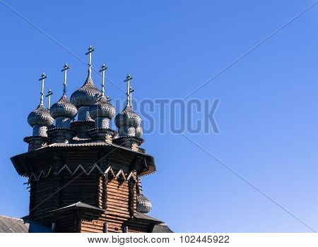 Russian Orthodox Churches with their domes and crosses against bright blue sky