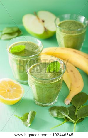 healthy green spinach smoothie with apple lemon banana