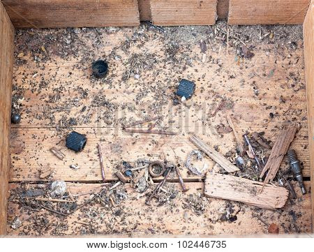 Old wooden box with remnants of old nails and tools