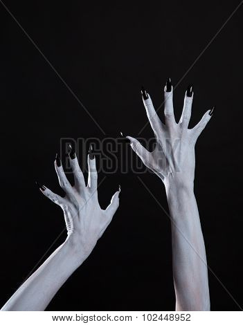 White ghost or witch hands with sharp black nails, body art, Halloween theme