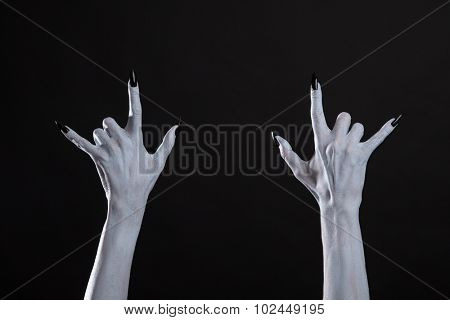 White monster hands showing heavy metal sign, Halloween or music theme