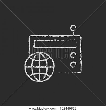 Retro radio hand drawn in chalk on a blackboard vector white icon isolated on a black background.