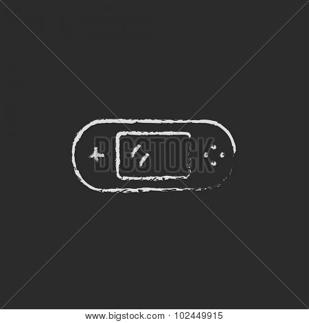 Game console gadget hand drawn in chalk on a blackboard vector white icon isolated on a black background.