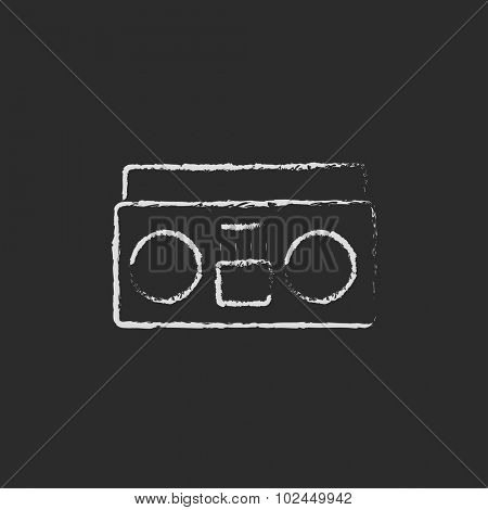 Cassette player hand drawn in chalk on a blackboard vector white icon isolated on a black background.