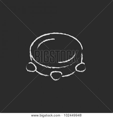 Tambourine hand drawn in chalk on a blackboard vector white icon isolated on a black background.