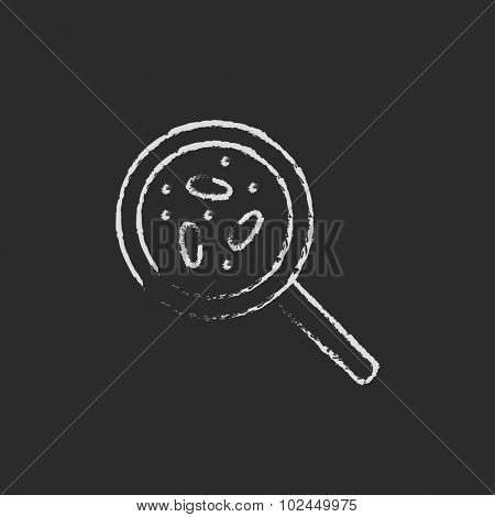 Microorganisms under magnifier hand drawn in chalk on a blackboard vector white icon isolated on a black background.