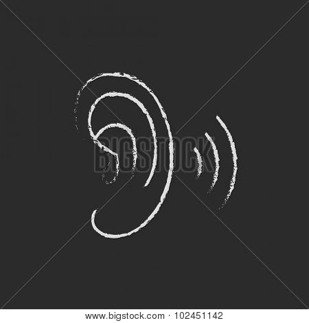 Human ear hand drawn in chalk on a blackboard vector white icon isolated on a black background.