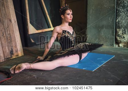 Ballerina sitting on the warm-up backstage