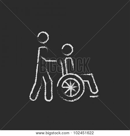 Nursing care hand drawn in chalk on a blackboard vector white icon isolated on a black background. Man pushing person in wheelchair.