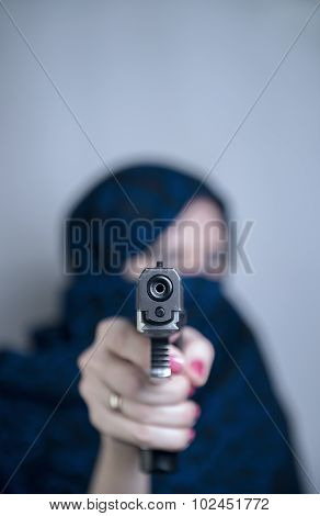 Woman Shoots A Gun