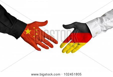 China and Germany leaders shaking hands on a deal agreement