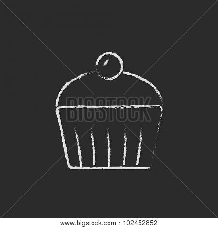 Cupcake with cherry hand drawn in chalk on a blackboard vector white icon isolated on a black background.