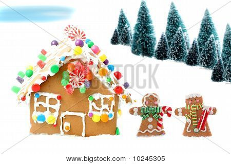 Gingerbread House With Men And Trees