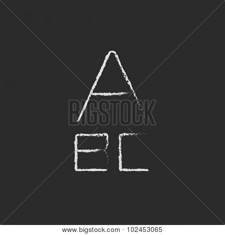 Letters hand drawn in chalk on a blackboard vector white icon isolated on a black background.