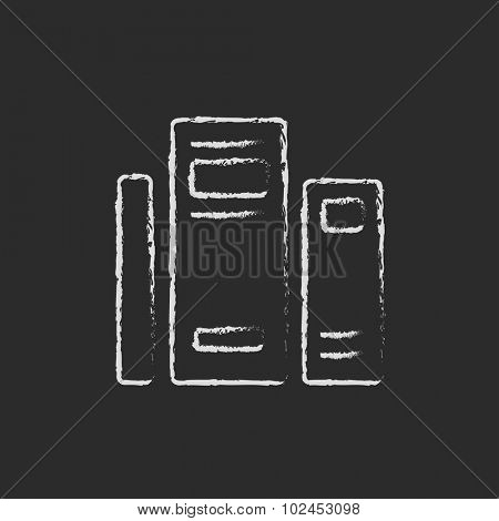 Books hand drawn in chalk on a blackboard vector white icon isolated on a black background.