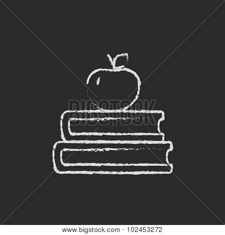 Books with apple on top hand drawn in chalk on a blackboard vector white icon isolated on a black background.