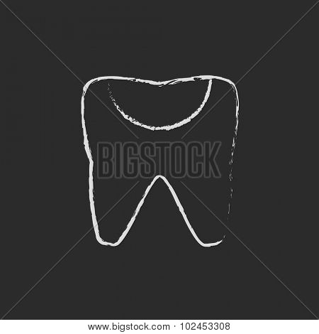 Tooth decay hand drawn in chalk on a blackboard vector white icon isolated on a black background.