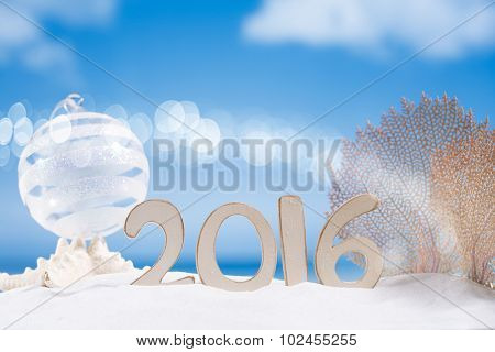 2016 numbers letters with starfish, glass ball, ocean , beach and seascape, shallow dof