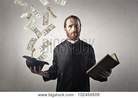 Money from the priest's hat