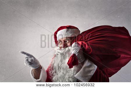 Santa Claus carrying a heavy bag