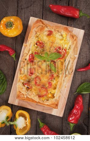 Phyllo pastry pizza with cheese and chili peppers