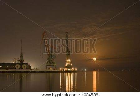 Cranes In The Port And Reflection Of Moon In The Water - Baku, Azerbaijan