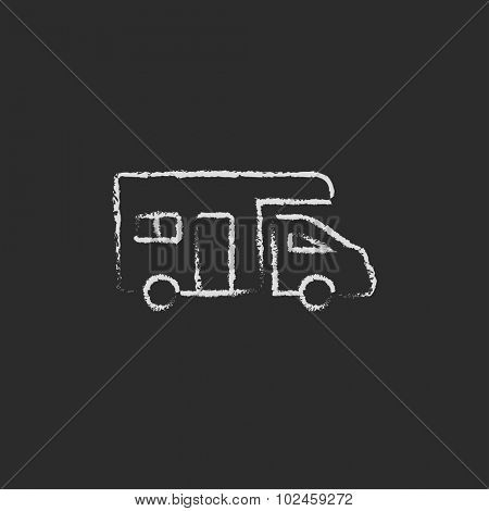 Camper van hand drawn in chalk on a blackboard vector white icon isolated on a black background.