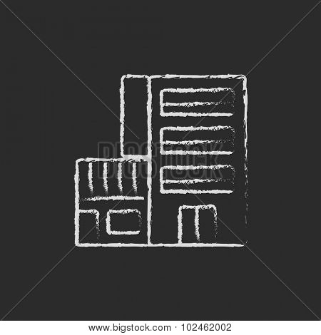 Hotel building hand drawn in chalk on a blackboard vector white icon isolated on a black background.