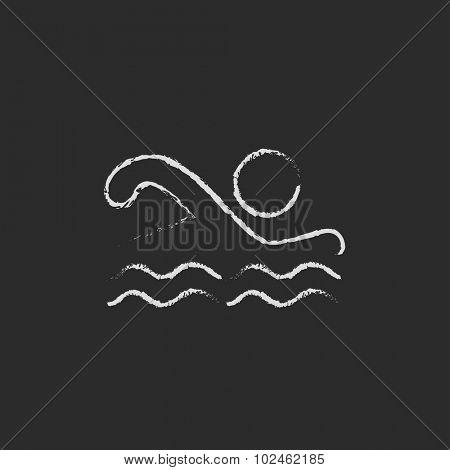Swimmer hand drawn in chalk on a blackboard vector white icon isolated on a black background.