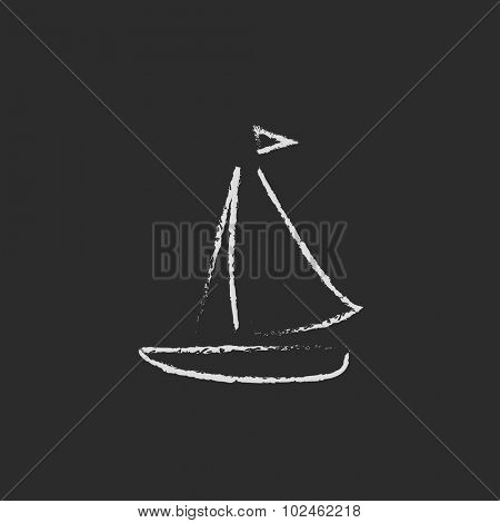Sailboat hand drawn in chalk on a blackboard vector white icon isolated on a black background.