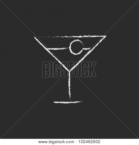 Cocktail glass hand drawn in chalk on a blackboard vector white icon isolated on a black background.