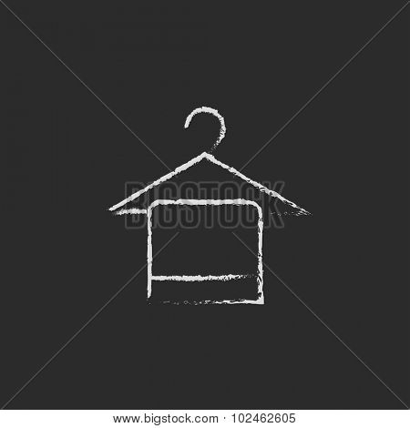 Towel on hanger hand drawn in chalk on a blackboard vector white icon isolated on a black background.