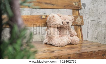 Teddybears on a park bench, selective focus