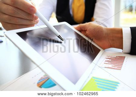 Close-up Image Of An Office Worker Using A Touchpad To Analyze S