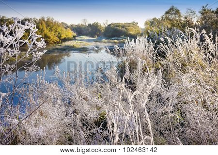 The first frost. Siberian river in autumn attire