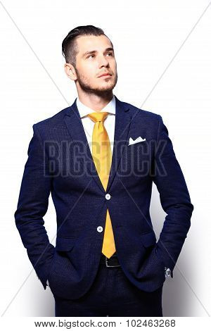 Young Handsome Man In Suit Looking At Copy-space Thinking Or Dre