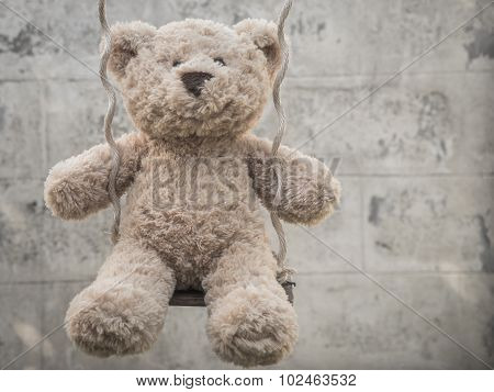 Teddybear on a swing