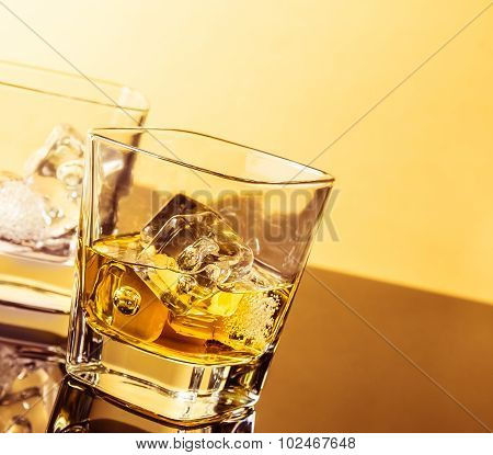 Two Glasses Of Whiskey On Table With Reflection, Warm Atmosphere